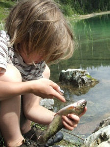 kid cleaning fish
